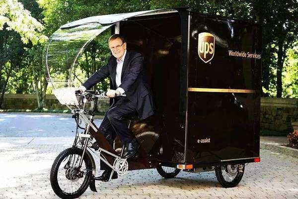 """UPS试点电动三轮车送货 国内遭遇""""身份缺失""""上路难"""
